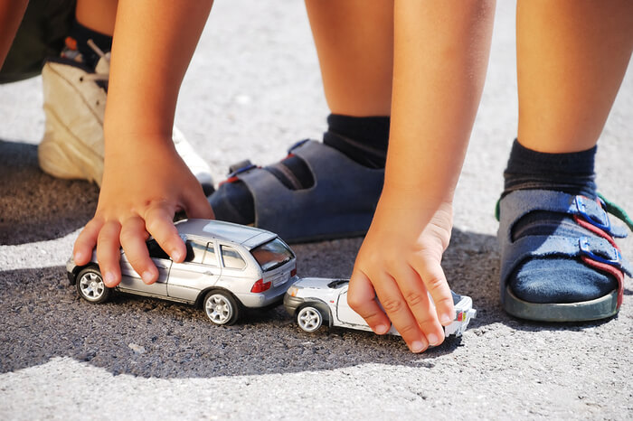 Children playing with toy cars
