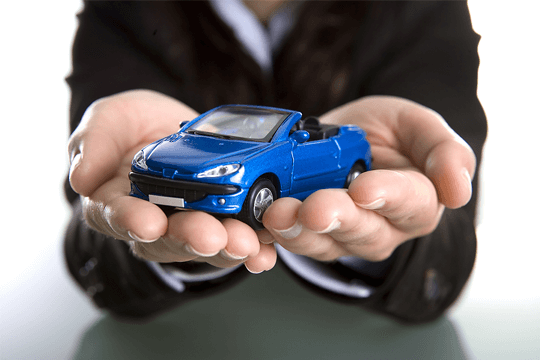 Man holding toy car
