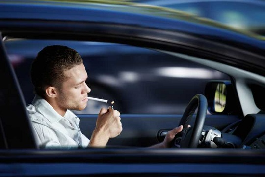 Man smoking in car