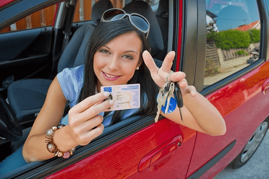 Woman in car with driving license