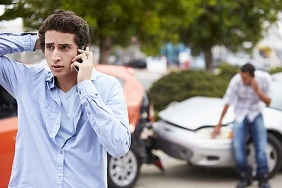 Teenage driver making phone call after crash