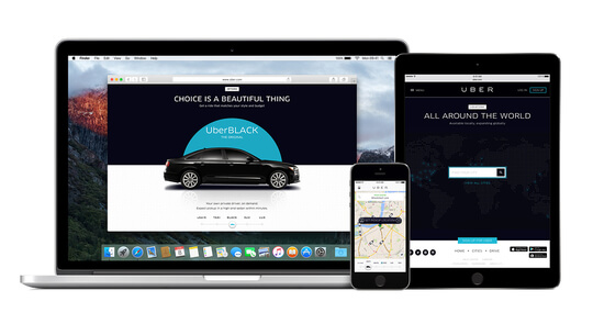 Uber app running on a laptop and mobile phone