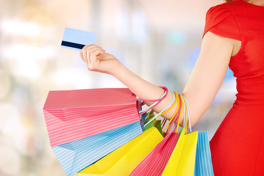 Woman with shopping bags and loyalty cards
