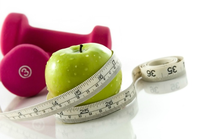 An apple with a tapemeasure
