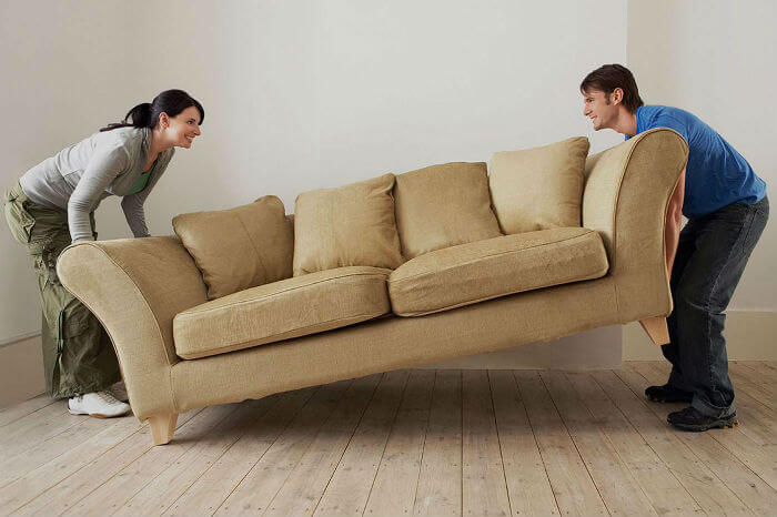 couple moving sofa